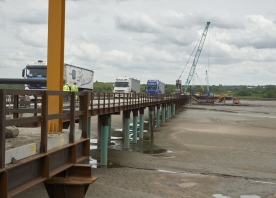 Delivering stone for the central cofferdam piling platform – May 2015