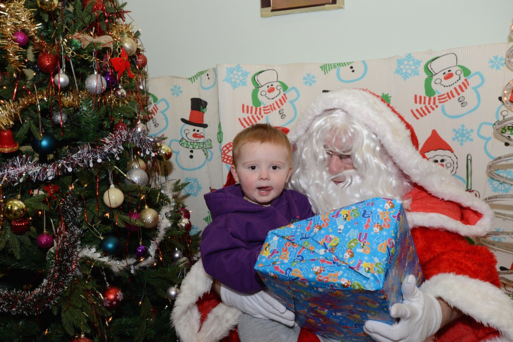 Oliver Timmiss (1), meets Father Christmas at the West Bank Community Centre, Widnes