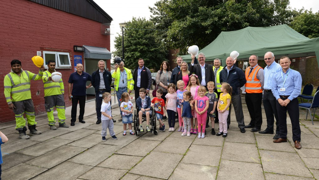 Staff from Merseylink, its subcontractors and West Bank Community Centre joining the children from Jiggys Childcare to celebrate the start of the construction of their new play area.