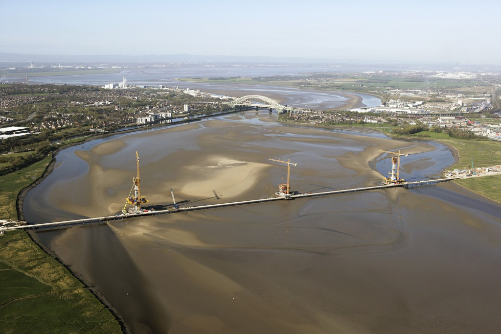 MG 1 aerial of bridge construction in the Mersey estuary